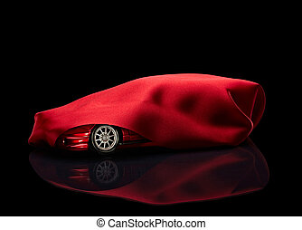 new car hidden under red cover - close up of a new car...