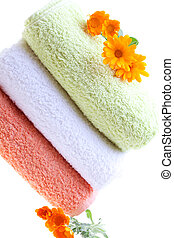 Clean Laundry - Pile of clean towels decorated with...