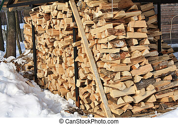 stock of firewood - Warehouse of firewood in the winter...