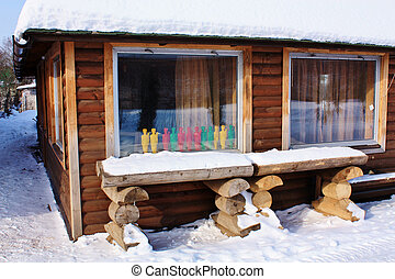 wooden house in snow - Rustic log cabin under a layer of...