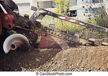 Trenching! Red machine in action.