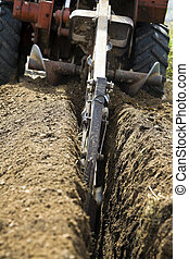 Trenching!   - Trenching! Red machine in action.