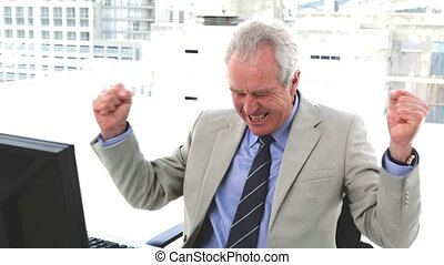 Boss very happy the arms raised in a office