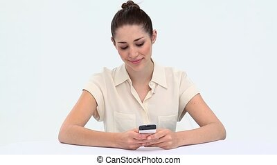 Young woman texting at a desk