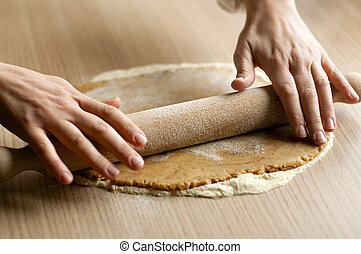 Mixing dough on the wooden board