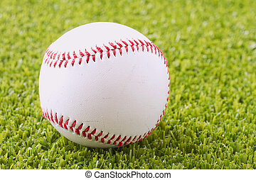 Baseball - A baseball over a green grass field