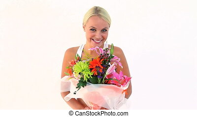 Blonde woman holding flowers