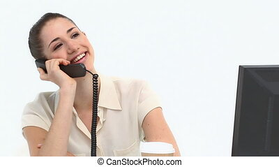 Young female worker on the phone