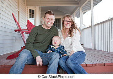 Young Happy Family on Porch