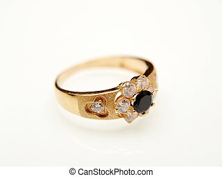 Yellow gold ring with black gemstone, towards white