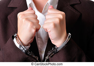 Handcuffed - Closeup of an handcuffed businessperson in a...