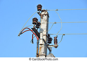 Old rural electric lines pylon on blue sky background