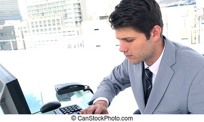 Businessman picking up a landline