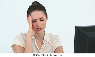 Sad woman in front of her computer against white background