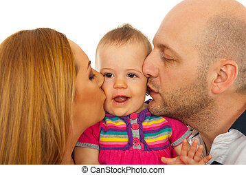 Mother and father kissing baby - Mother and father kissing...