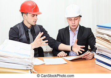 Two engineers meeting - Architect and construction engineer...