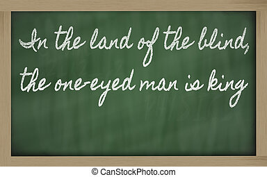 handwriting blackboard writings - In the land of the blind, the one-eyed man is king