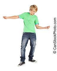 teenage boy playing air guitar