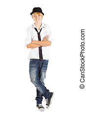 teen boy standing legs crossed on white background