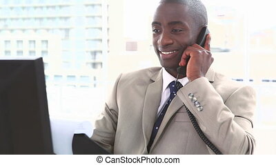 Businessman on the phone holding files