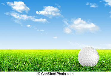 Close-up of golf ball with green grass for web design...