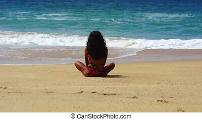Relaxing at a Tropical Beach - Latin woman relaxing at a...