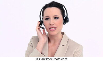 Woman in suit using a headset against white background