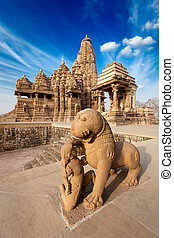 King and lion fight statue and Kandariya Mahadev temple...