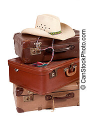 Pile of old suitcase with hat on top on white backgroud