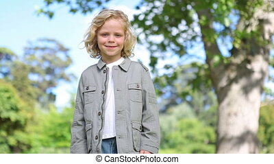A little boy standing and smiling