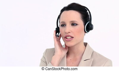 Young businesswoman speaking with a headset against white...