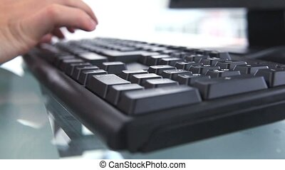 Close-up on someones's hands typing on a keyboard