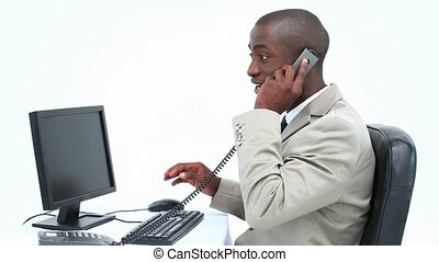 Businessman receiving a good news by phone against white...