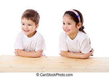 Two smiling kids at the desk
