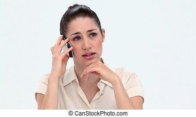 Sad young woman on the phone