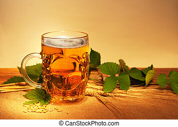 beer on sacking with wheat and hop still-life