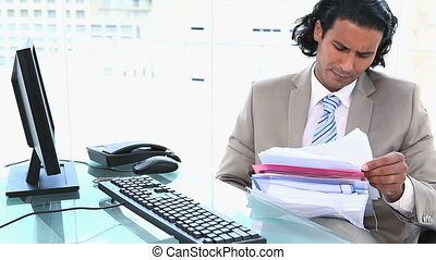 Latin businessman overworked in an office