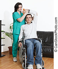 Physical therapist working with patient - Young Man Working...