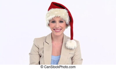 Businesswoman wearing a Santa Claus hat