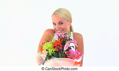 Blonde holding a flower bouquet