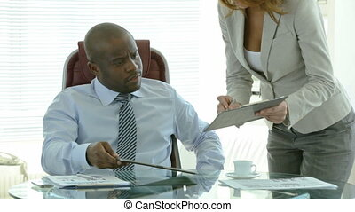 Put your signature - Secretary giving her boss documents to...
