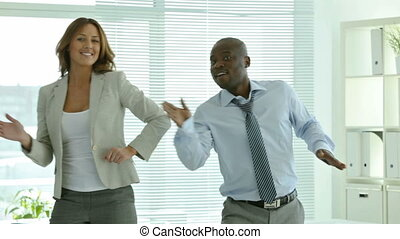 Business dance - Businesspeople dancing cheerfully in office...