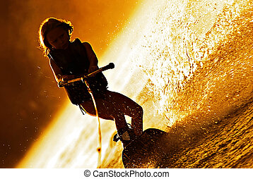 Girl Wakeboarding Silhouette - A very young girl on a...