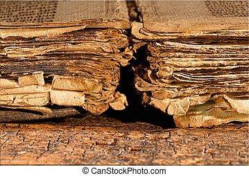 Tattered pages of antique book