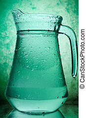 water in a glass pitcher