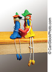 Two comic characters made from clay and string