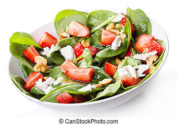 salad with strawberry, spinach leaves and feta cheese on...