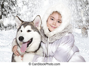 Malamute dog with a girl - Five month old malamute puppy...