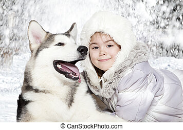 Malamute with a girl - Little girl embrace five month old...