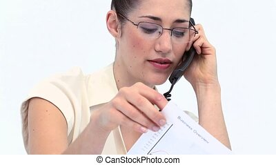 Businesswoman with statistics on the phone